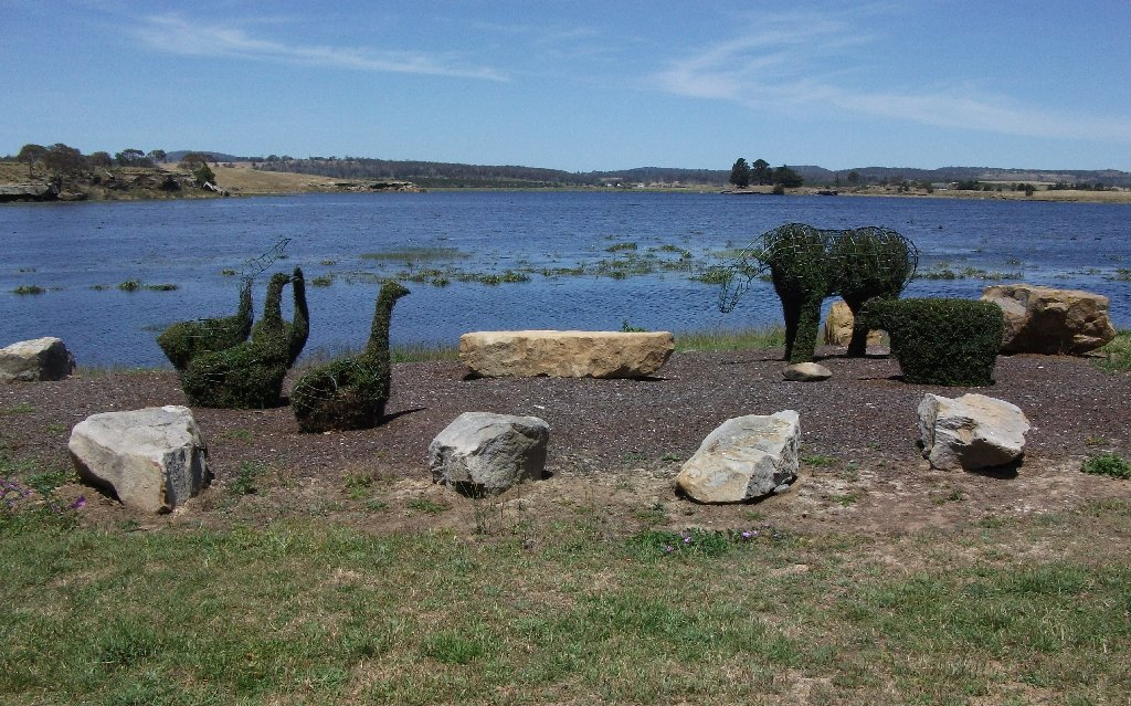 image topiary group by lake.