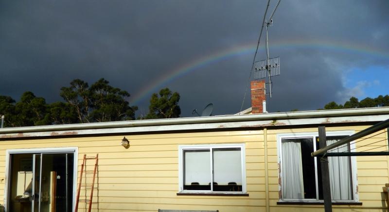 Rainbow in a dark sky.