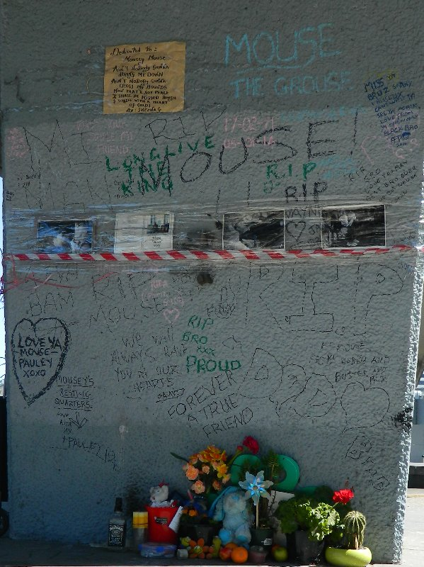 """Tributes left for Wayne """"Mouse"""" Perry who was murdered near this spot earlier this year."""