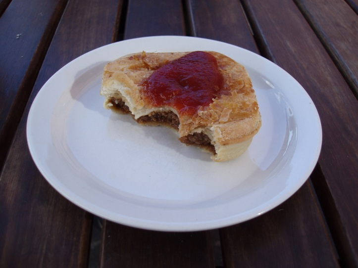 meat pie and tomato sauce by freeaussiestock.com is licensed under a Meat pie and sauce. Creative Commons Attribution 3.0 Unported License.
