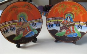 A pair of hand painted plates made in Japan.