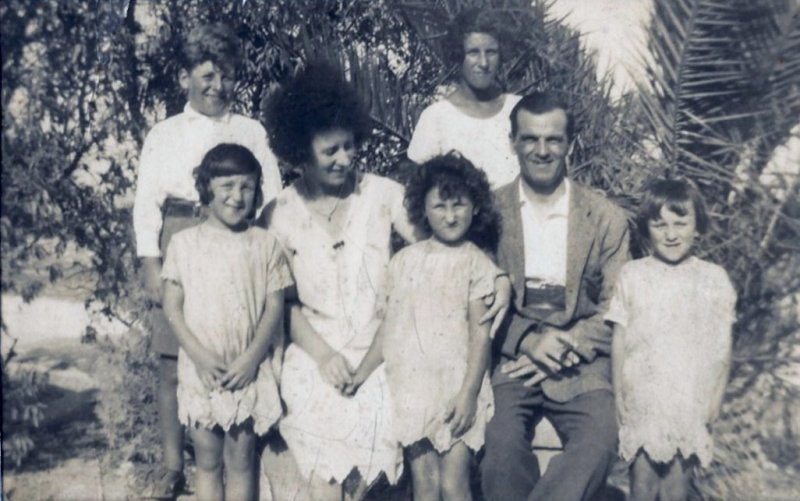 Mum with her family, I think this was around 1925 or thereabouts. Mum is the curly haired one in the middle.