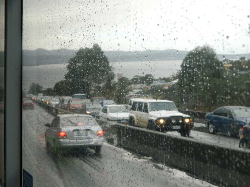 Cars bank up as the weather turns bad. This is about 4km from Hobart.