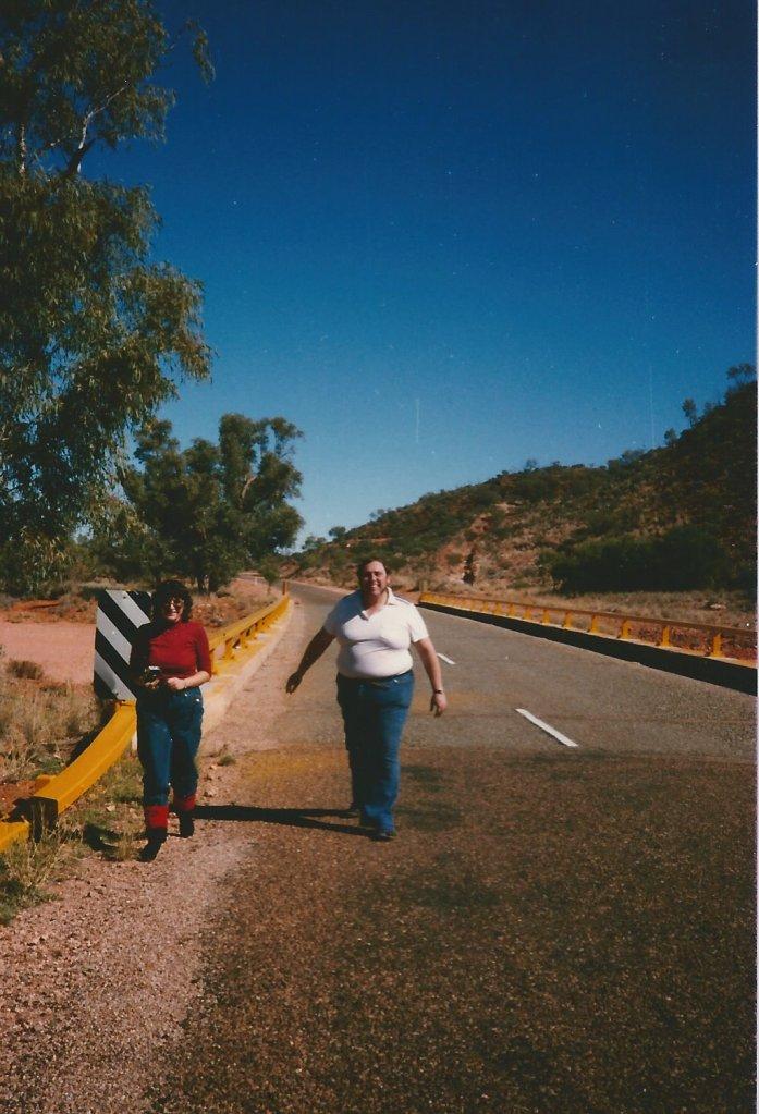 Walking on the road to Uluru