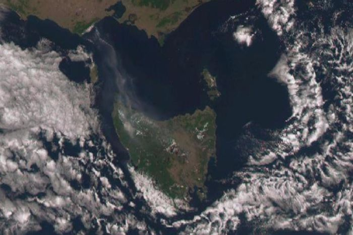 A satellite image showing a smoke plume from Tasmania Posted 16 Jan 2016, 3:04pm A large plume of smoke drifts north from Tasmania's north west and west coast where dozens of fires burn. Supplied: Bureau of Meteorology