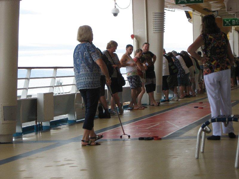 Playing Shuffleboard on board ship.