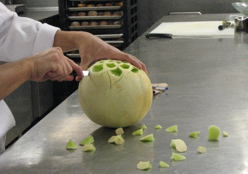 Carving a melon.