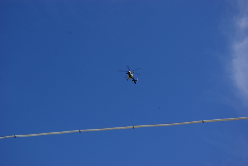 Helicopter against a blue, blue sky