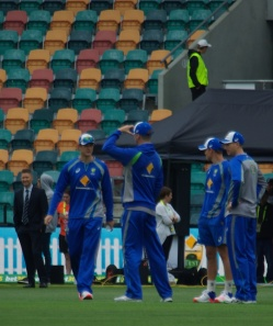 Former Australian Captain Michael Clarke watches the warm up.