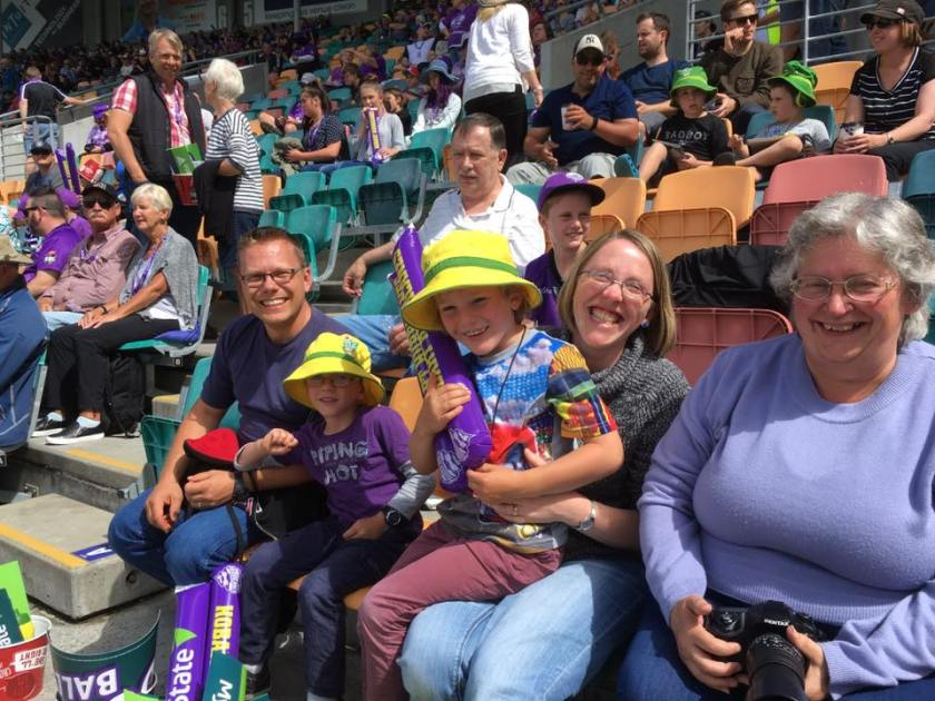 Four happy Hurricanes fans and one contrary minded Scorchers fan in the middle.