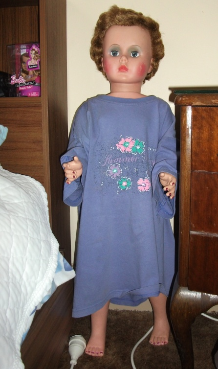 This big doll was for sale at a market wearing an old kids T shirt.