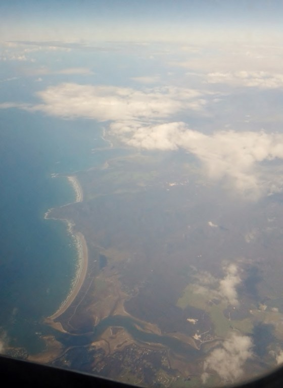 Looking down at the northern coast of Tasmania, the river is probably the Mersey at Devonport.
