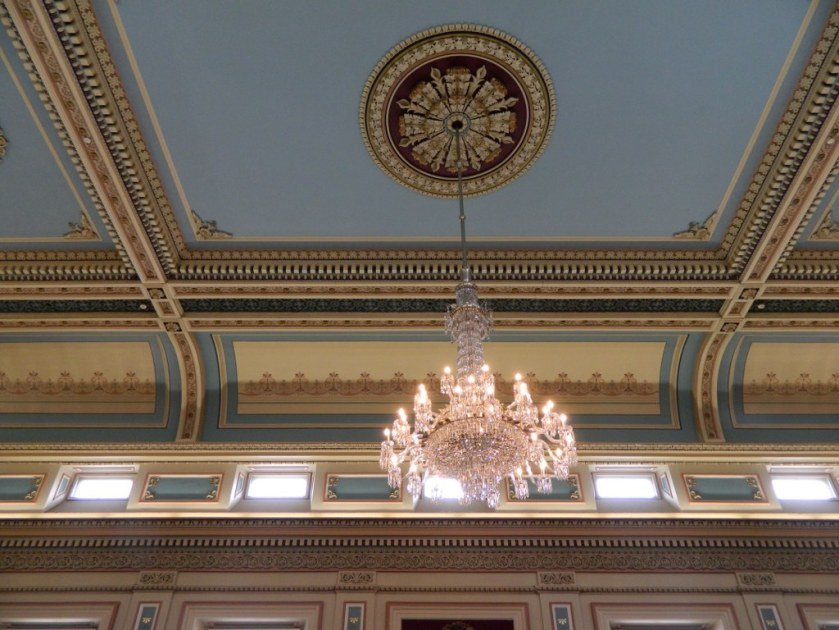 Looking up at the ornate ceiling and lighting at Hobart Town Hall.