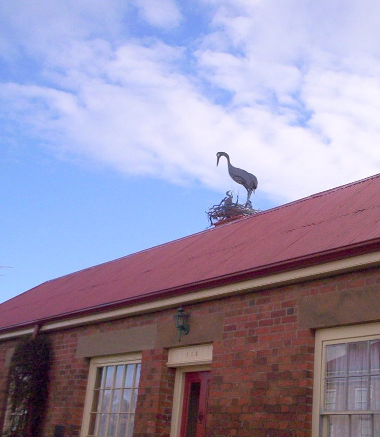 Stork sculpture on the roof Blossom Cottages Oatlands