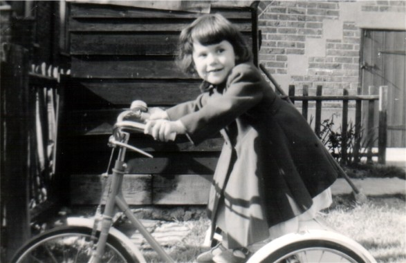 Naomi aged around four I think, on my tricycle.