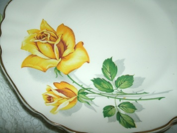 Beautiful yellow rose on a bone china dish made in England