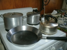 Some of Mum's old pots and pan plus my whistling kettle on the stove
