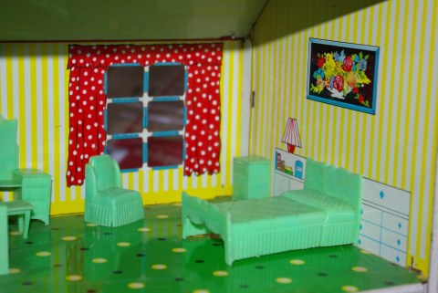 Bedroom furniture by Marx in a Chad Valley dolls house.