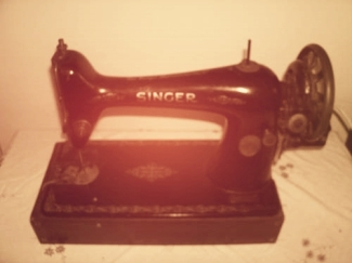 Electric Singer Sewing Machine. This is an early one.