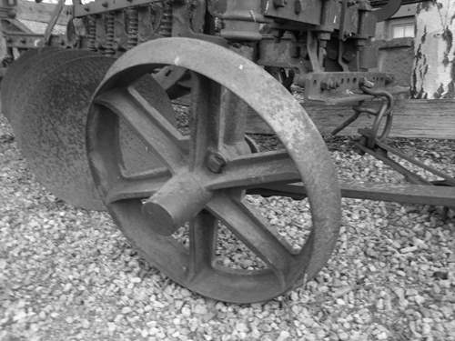 Wheel on some old machinary