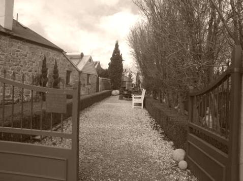 Gravel path leading into garden art business