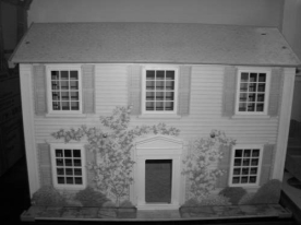 This is Rosewood Manor one of my doll houses. Doll houses were made to look like the real thing so little girls could play house.