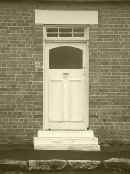 Front door and red brickwork of small cottage Oatlands