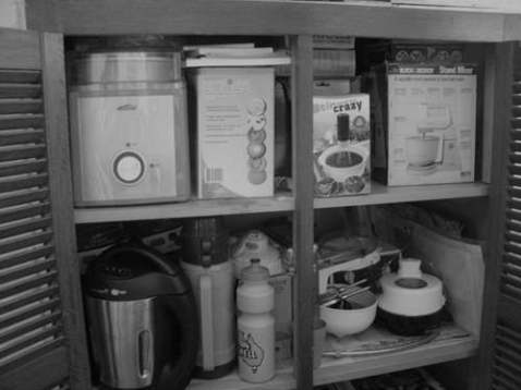 This cupboard is in the chimney where the old wood oven would have been. These are my gadgets mostly newer ones.