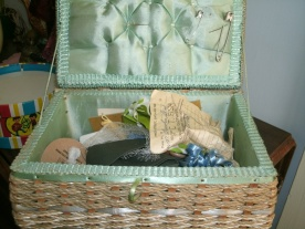 vintage sewing basket showing surprise contents