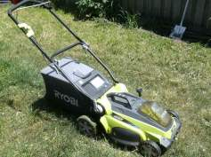 My wonderful electric lawnmower. Beats the hell out of trying to start the old one.