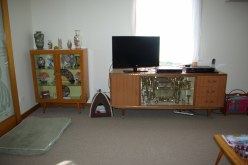 """My """"Mid-Century """" furniture. The buffet belonged to David's parents. I bought the china cabinet to match it."""