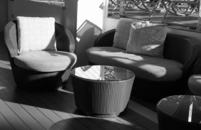 Wicker tub chairs on the pool deck