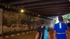 A mural under a bridge