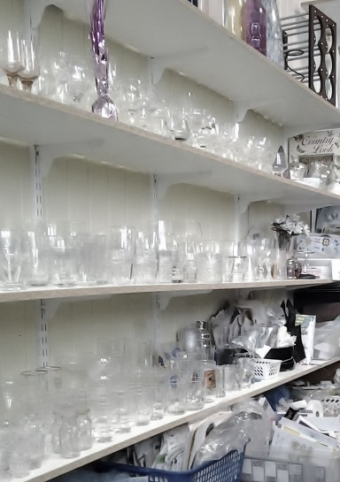 Shelves of glasses at the Op Shop