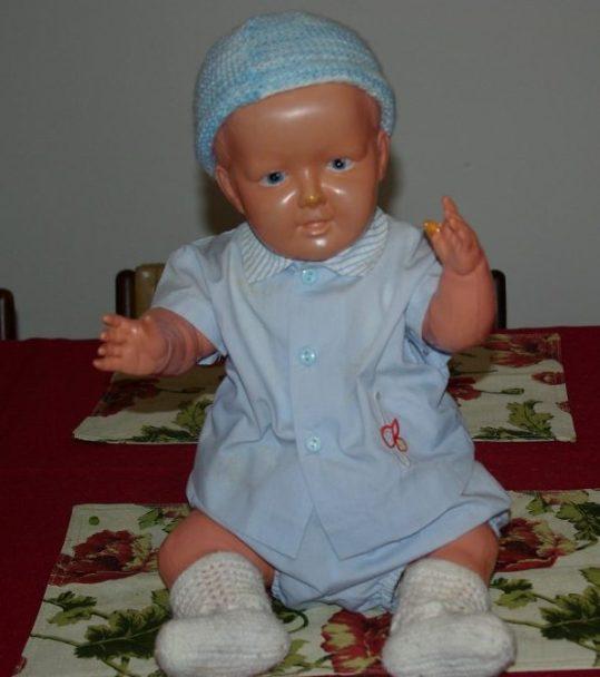 Celluloid baby John in pastel blue.